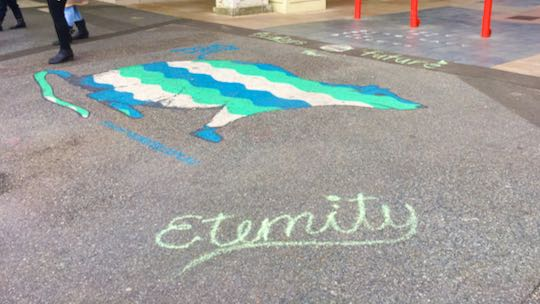 Example: Eternity written in chalk. Colurful rat picture in background.