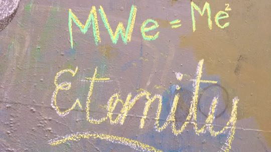 "Example: Eternity DOTS and 'MWe=Me2"" written in chalk on wall"