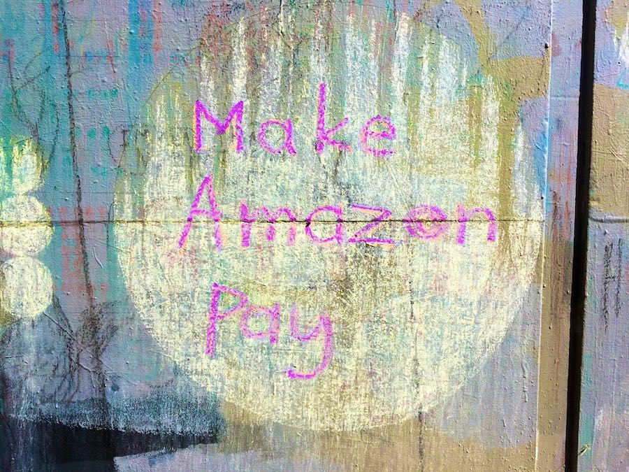 "Example ""Make Amazon Pay' in chalk, with dots"