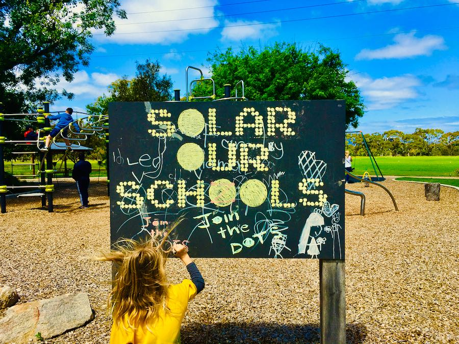 Example: 'Solar Our Schools' in Chalk, child chalking
