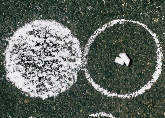 Example: Infinity DOTS in chalk on bitumen. Two chalk stubs.