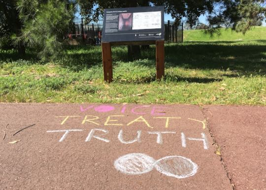 Example: Infinity DOTS with words 'Voice, Treaty, Truth' in chalk